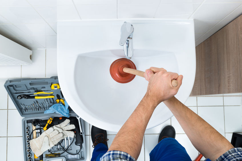 plumber unclogging a drain naturally in carrollton tx