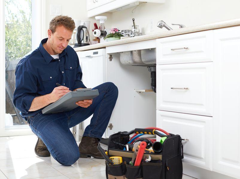plumber in aubrey tx fixing kitchen sink